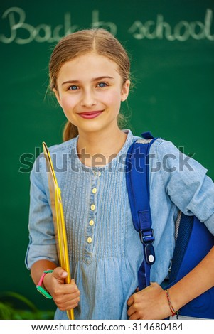 Back to school, education - young and beautiful schoolgirl - stock photo