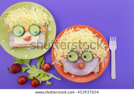 Back to school fun school lunch with happy faces sandwiches and healthy ingredients, with copy space. - stock photo