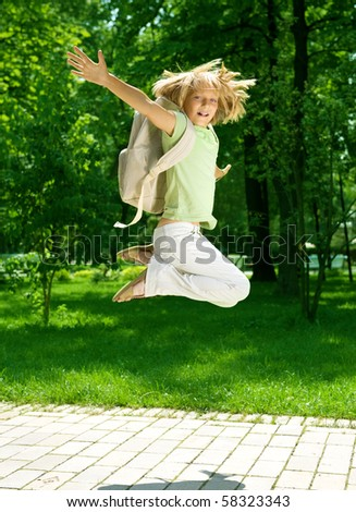 Back to School.Happy Schoolgirl Outdoor - stock photo