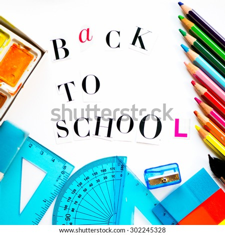 Back to School Letters cut out from the Magazine with colourful pencils, paints, brushes, rulers and stickers - stock photo