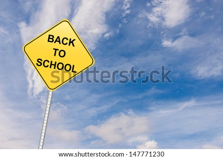 Back to School motivational road sign and blue sky with copy space. - stock photo