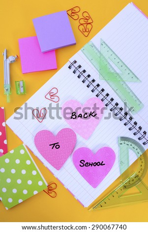 Back to School or Education Concept with stationery and desk accessories overhead on bright yellow background.  - stock photo
