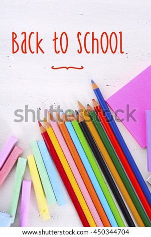 Back to School or Education Concept with stationery and desk accessories overhead on white wood rustic table with retro hand drawn style text. - stock photo