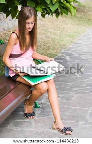 Back to school, portrait of a beautiful friendly teen student girl.