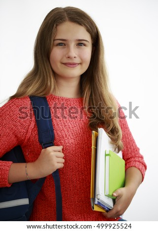 Back to school. Portrait of teenage girl with backpack and notebooks on white background.