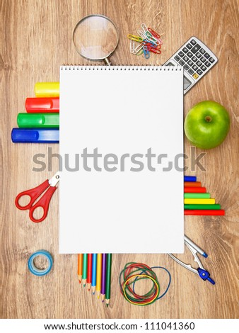 Back to school. School accessories on a wooden background. - stock photo
