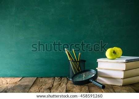 Back to school. School background with supplies. Pencils, apple and school equipment.