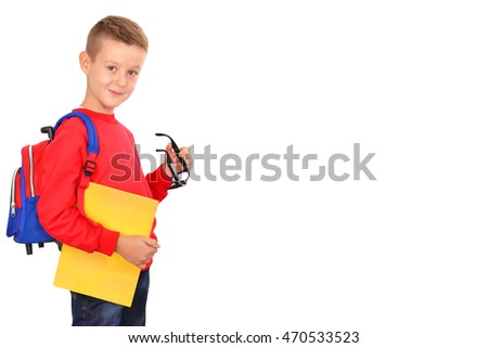 Back to school. Schoolboy. Looking at camera. School concept.