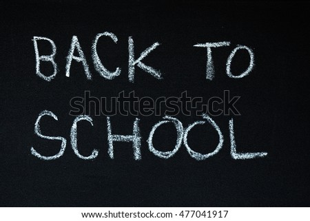 back to school sentence written on a chalkboard. symbol for the beginning of a school year