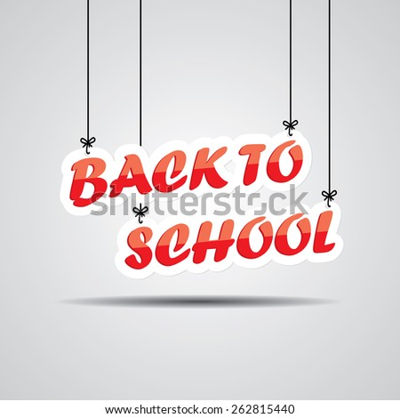 Back To School Sign Hanging On Gray Background. - stock photo