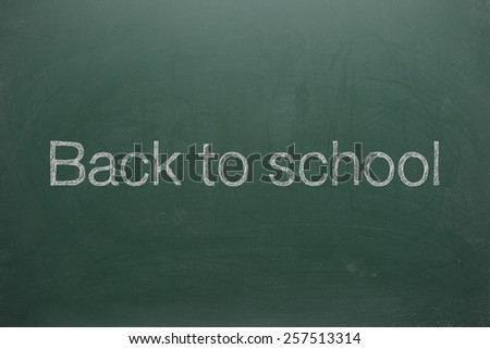 Back To School Sign On Green Board - stock photo