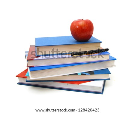 back to school: stack of books with red apple and pen on top over white background