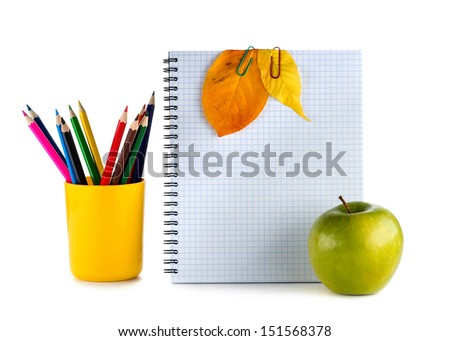 Back to school.The composition of the book with autumn leaves, apple, globe and pencils in the glass.  - stock photo