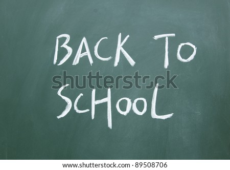 back to school title drawn with chalk on the blackboard - stock photo