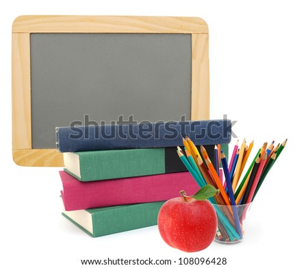 Back to school with books, pencils and chalkboard - stock photo