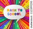Back to school words in speech bubble on colorful rays. Raster version, vector file available in portfolio. - stock vector