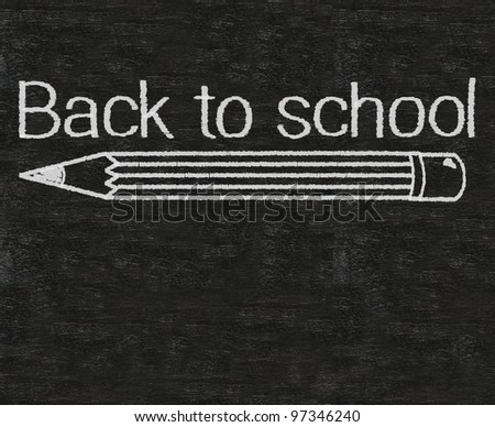 back to school written on blackboard background with pencil - stock photo