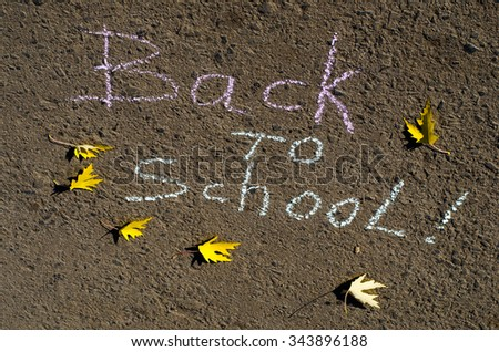 back to school written with chalk on asphalt