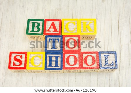 Back to school written with wooden cubicle letters