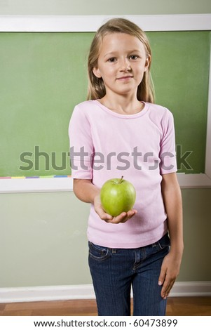 Back to school - 8 year old girl with apple for teacher