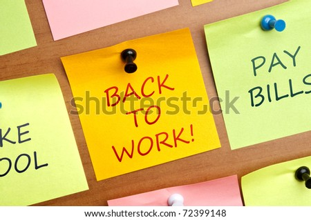 Back to work post it on wooden wall - stock photo