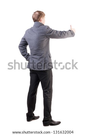 Back view business man in coat shows thumbs up. Rear view people collection. backside view of person. confident man in autumn clothes positive gestures.  Isolated over white background. - stock photo