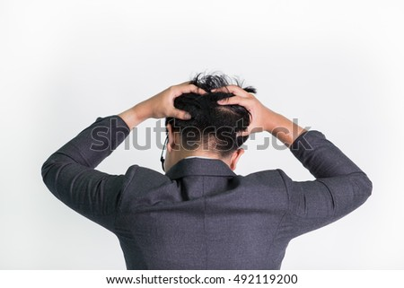 Back view businessman putting hands on the nape. white isolated