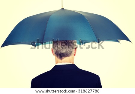 Back view businessman with umbrella. - stock photo