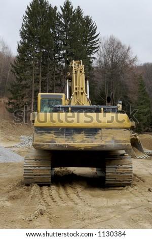 Back View Excavator - stock photo