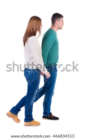 Back view going couple. walking friendly girl and guy holding hands. Rear view people collection. backside view of person. Isolated over white background. A pair of warm sweaters goes right hand in