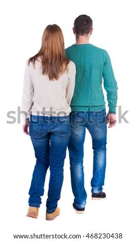 Back view going couple. walking friendly girl and guy holding hands. Rear view people collection. backside view of person. Isolated over white background. Couple in warm jackets out into the distance