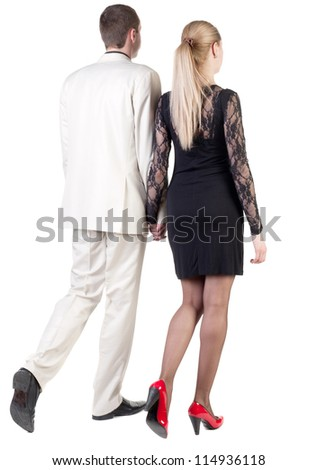 Back view going young business couple (man and woman). walking beautiful friendly girl in dress and guy in suit. Rear view people collection. backside view of person. Isolated over white background. - stock photo