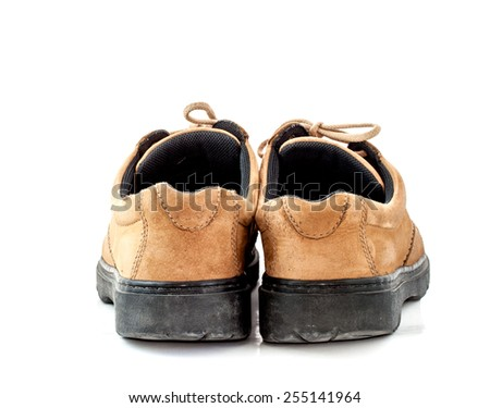 back view image of a pair of old leather brown shoes on white background - stock photo