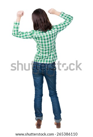 Back view joyful woman celebrating victory hands up. Rear view people collection. backside view person. Isolated over white background. slender brunette in a jeans shows symbol success or hitchhiking - stock photo