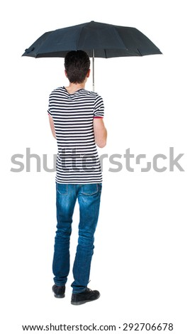 Back view man in jeans under an umbrella. Standing young guy. Rear view people collection. backside view person.  Isolated over white background. guy in the striped shirt standing under black umbrella - stock photo