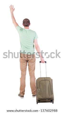 back view man with suitcase. brunette guy waves his hand. backside view person.  Rear view people collection. Isolated over white background. guy with the travel bag waving to someone in the distance - stock photo