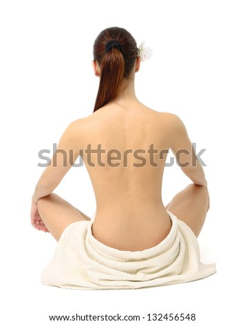 Back-view of a beautiful woman sitting on the floor, isolated on white background