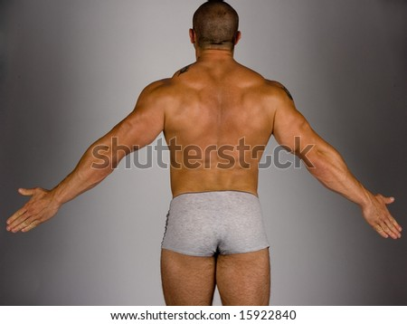 Back view of a body builder - stock photo