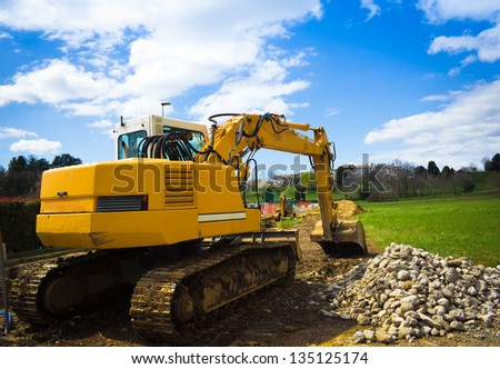 back view of a bulldozer in a sunny day - stock photo