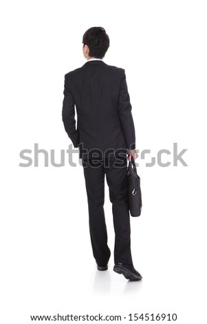 back view of a business man holding a briefcase and walking forward on white background - stock photo