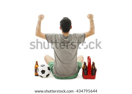 Back view of a excited man with soccer ball and pack of beer looking at wall. Rear view. Isolated on white background
