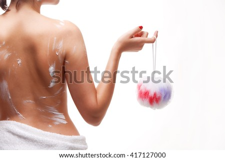 Back view of a woman body in the shower isolated on white