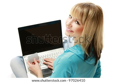 Back view of a woman holding a credit card and a laptop, isolated on white background - stock photo