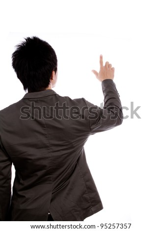 Back view of a young business man pointing at something over white background