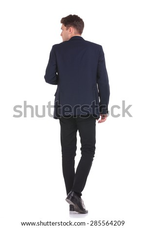 back view young business man walking の写真素材 今すぐ編集