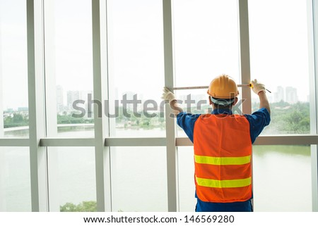 Back view of an architect with a measuring tape - stock photo