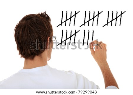 Back view of an attractive young man counting. All on white background. - stock photo