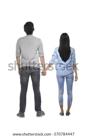 Back view of asian couple isolated over white background