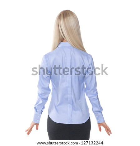 back view of beautiful blonde business woman.Young girl in black skirt and blue blouse.  Isolated over white background. - stock photo