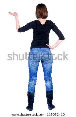 Back view of beautiful business woman looking at wall. Rear view. Isolated over white.